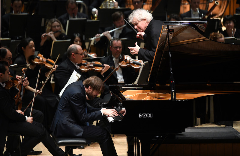 Daniil Trifonov with conductor Sir Simon Rattle and the London Symphony Orchestra (credit LSO/Doug Peters)